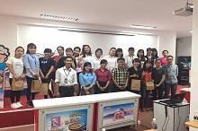 The students take photo with the representative of Acecook Joint Stock Company